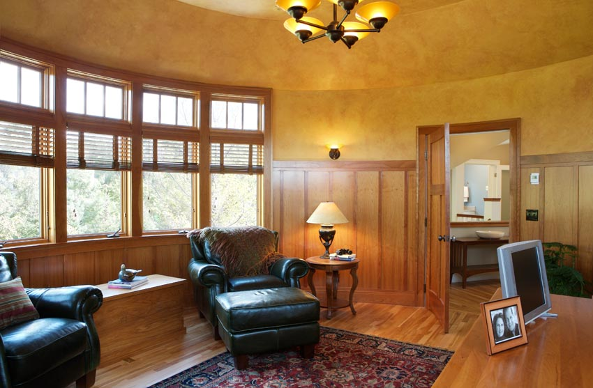 Aune/Miller Residence: The office with wood paneling and plastered walls