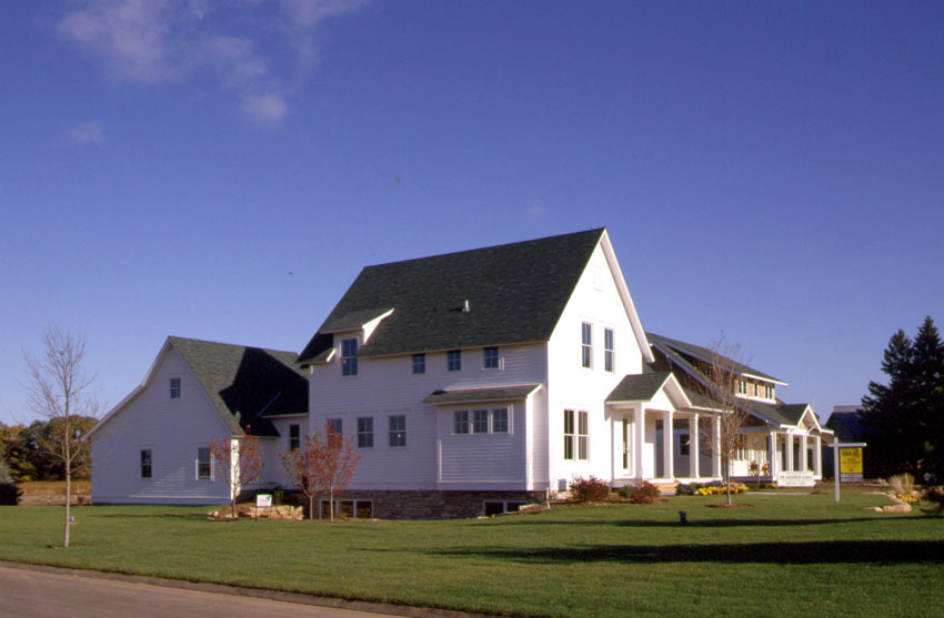 Prairie Farmhouse: Exterior from the side showing mudroom and attached garage