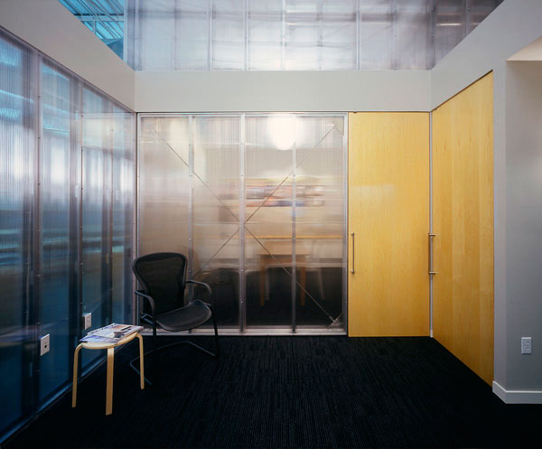 SALA Architects: Waiting area with conference room doors closed