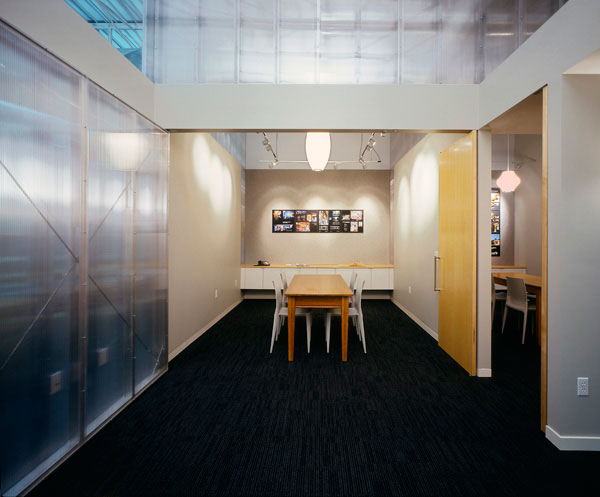 SALA Architects: Waiting area with conference room doors open